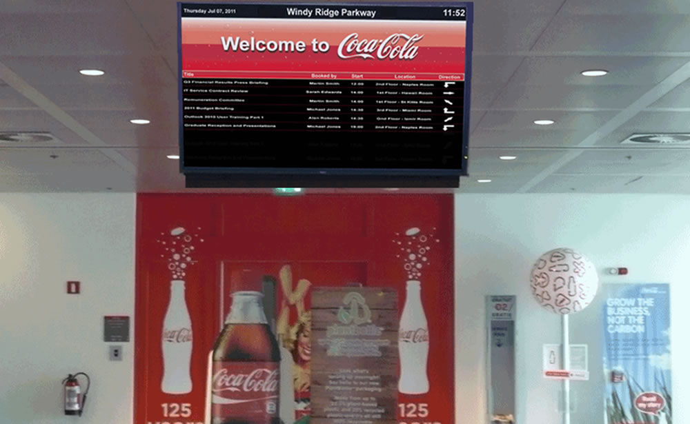 Wayfinder screens can incorporate status colours and arrows to help staff and visitors locate rooms.